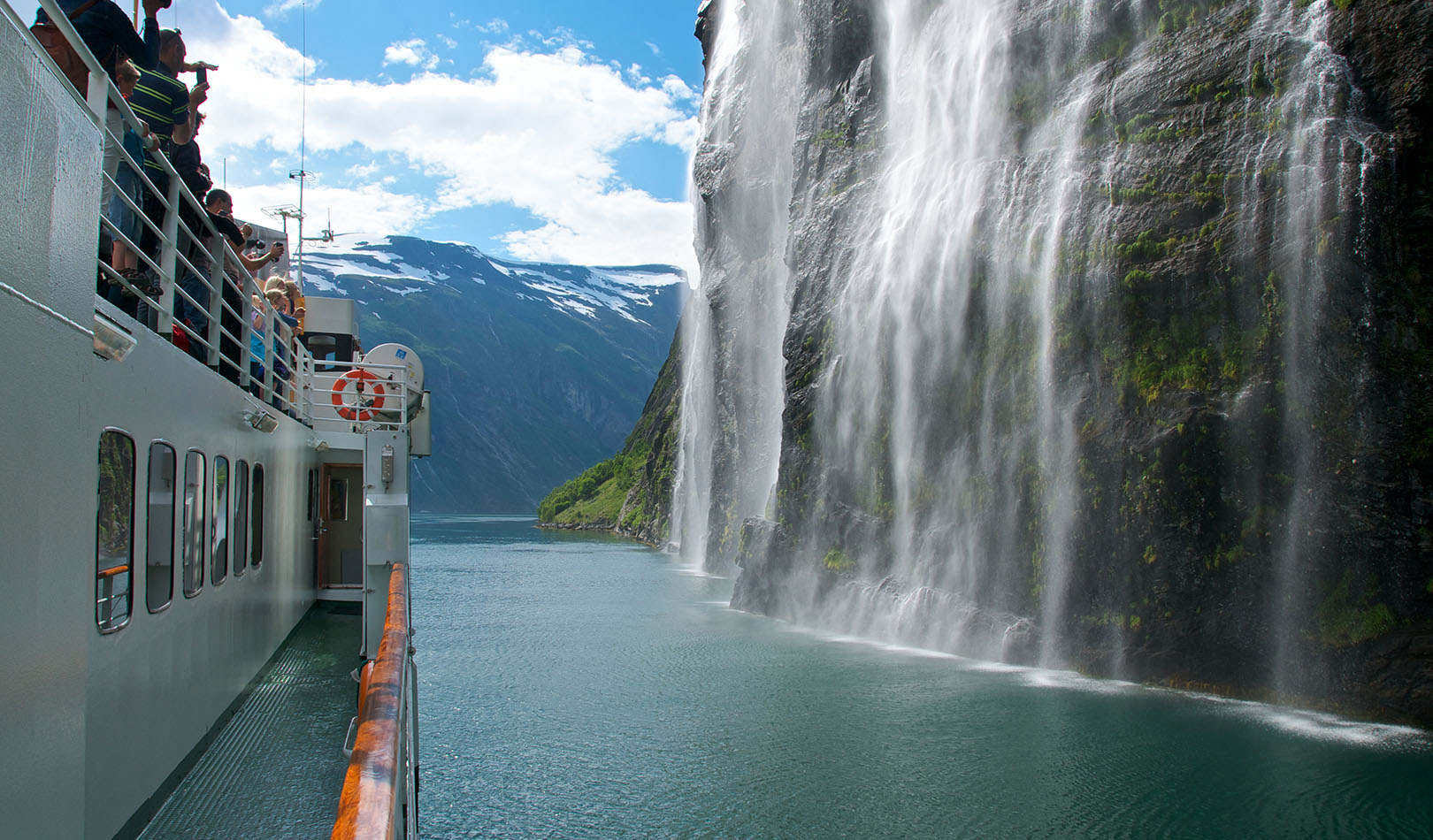 Ferry close til the waterfalls The brides veil in the Geiranger fjord.