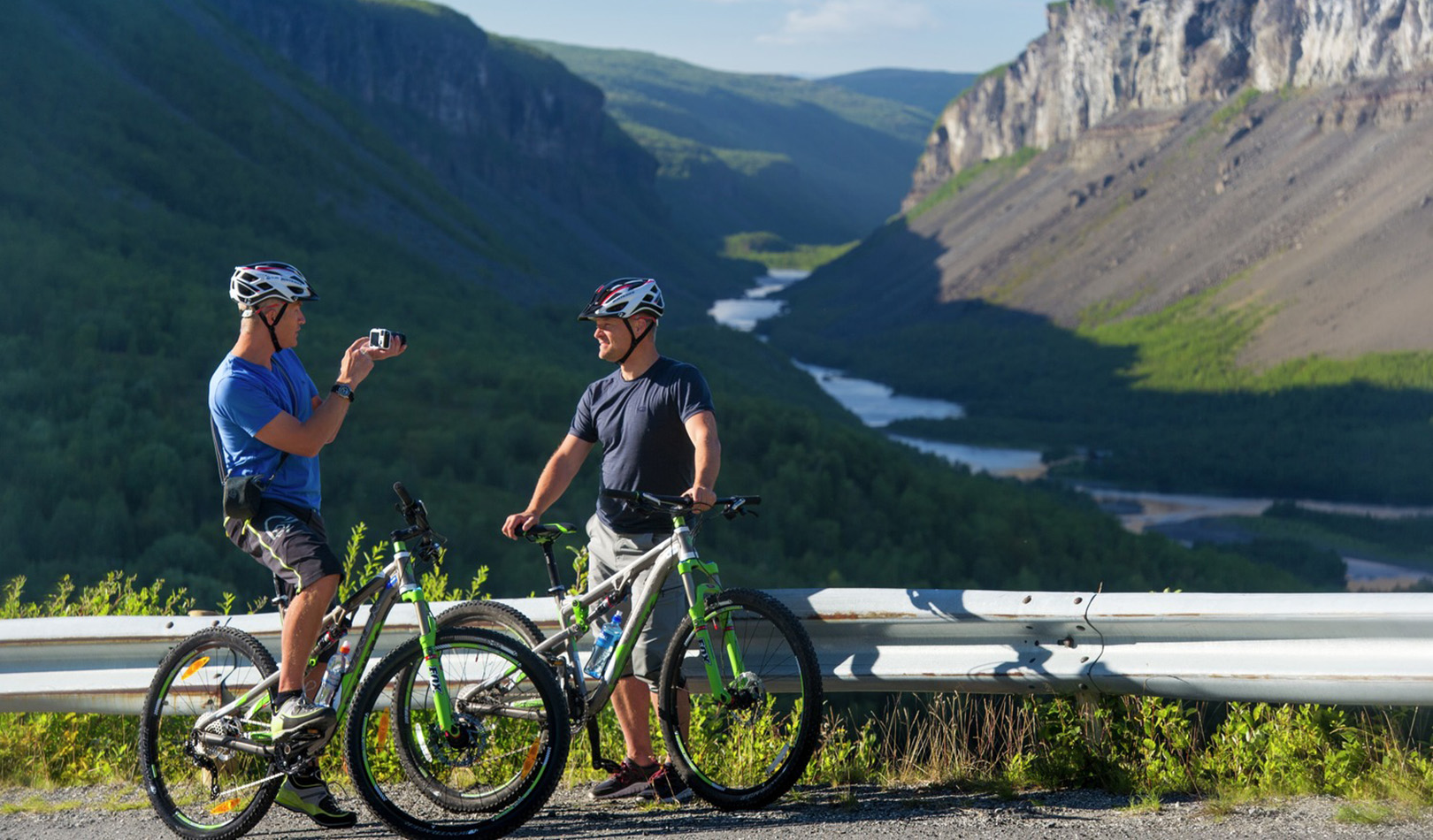 Two cyclists taking a break and filming each other i Finnmark.