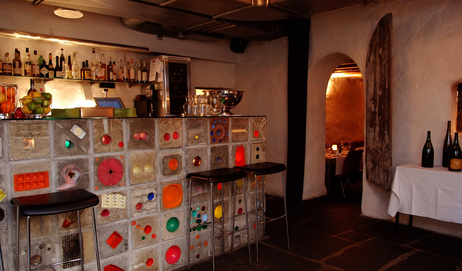 Interior of Altona winebar in Augustin Hotel in Bergen, with colorful details.