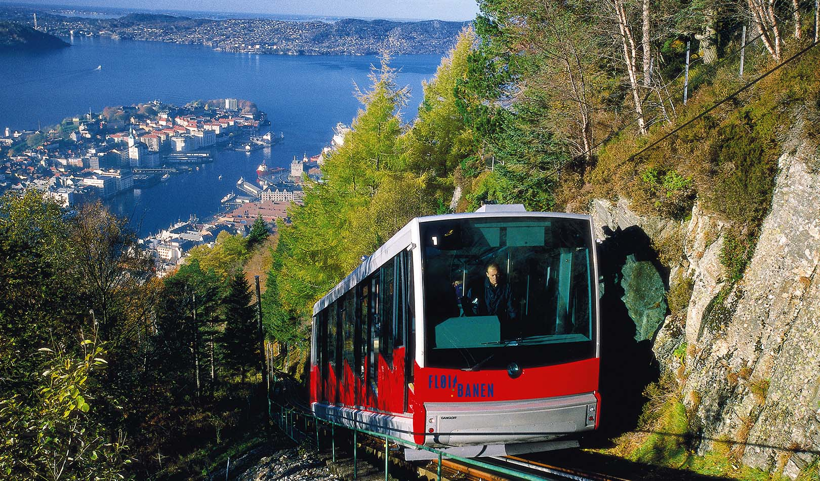 Funicular on the way up to the mountain Fløien with Bergen in the background.
