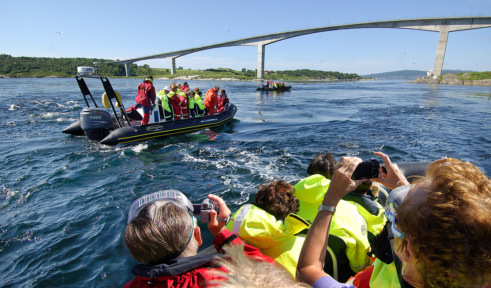 People on a RIB tour by the bridge of the maelstrom Saltstraumen outside Bodø.