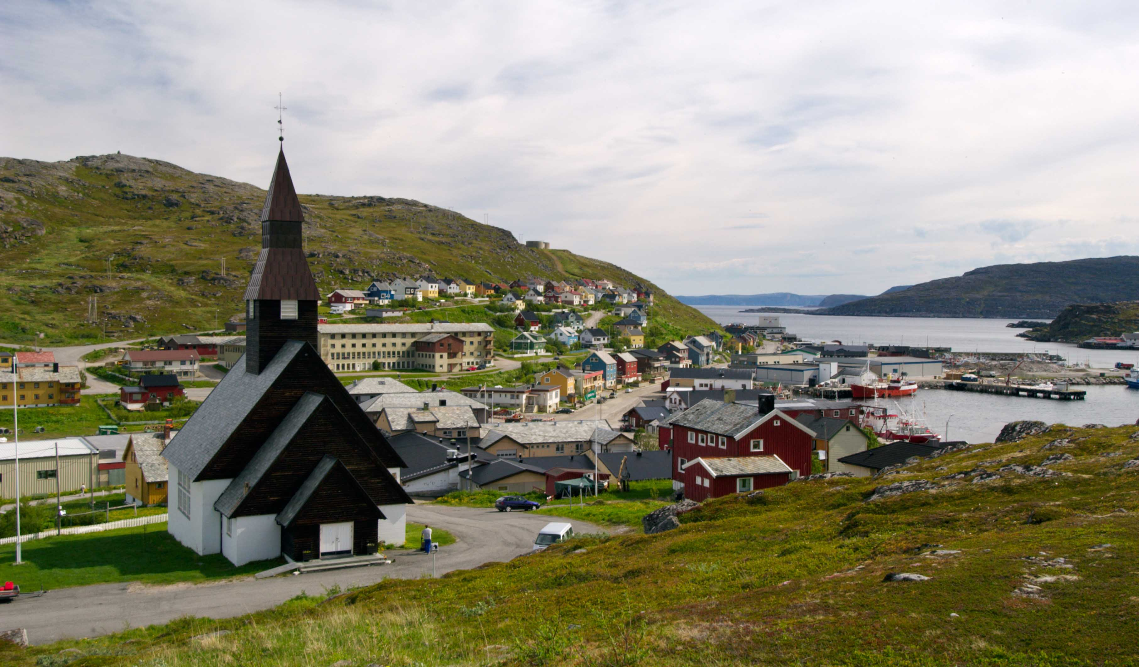 Church and houses in the small town of Havøysund in Måsøy, Finnmark.