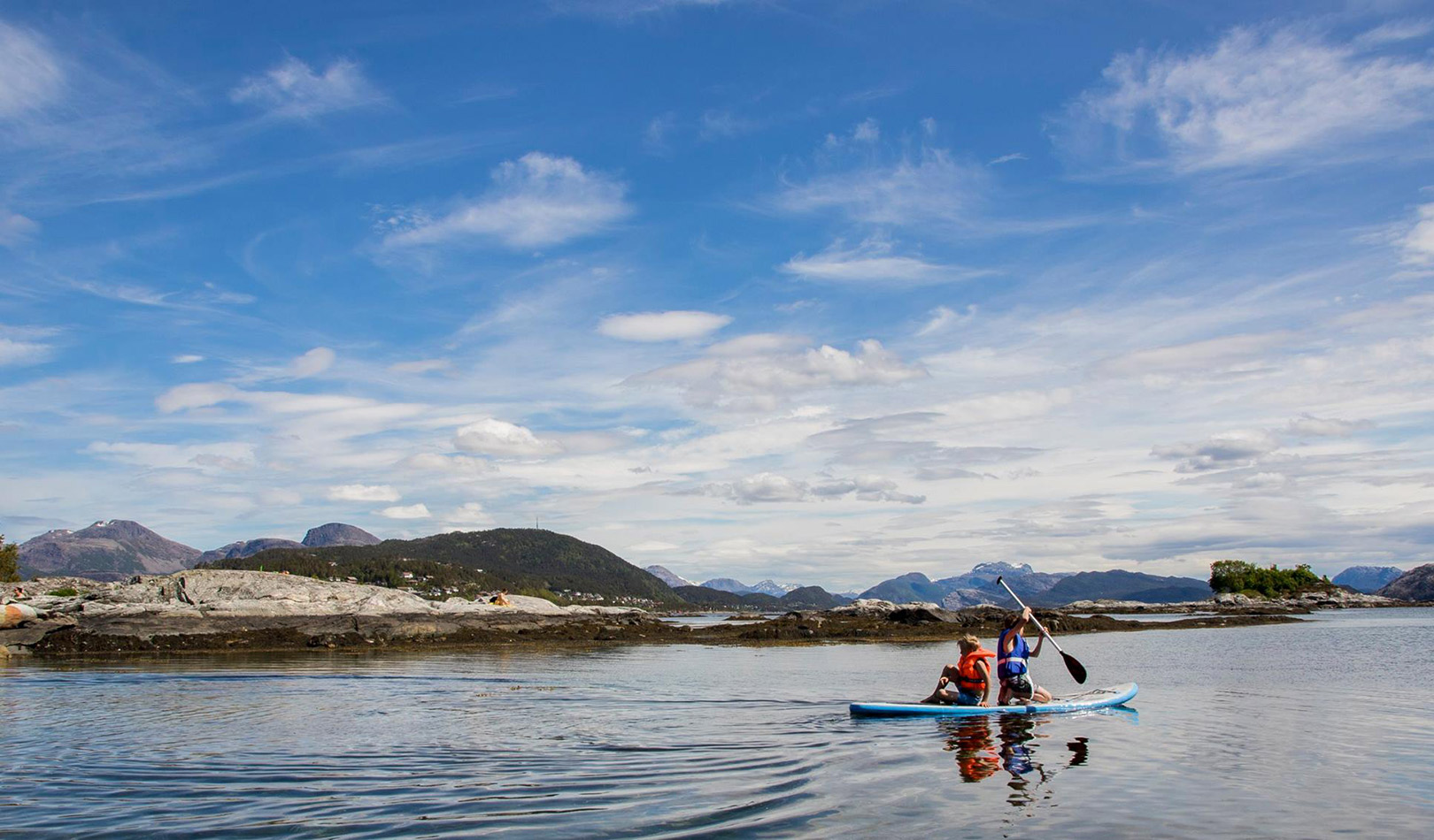 Two people in a kayak outside Florø.