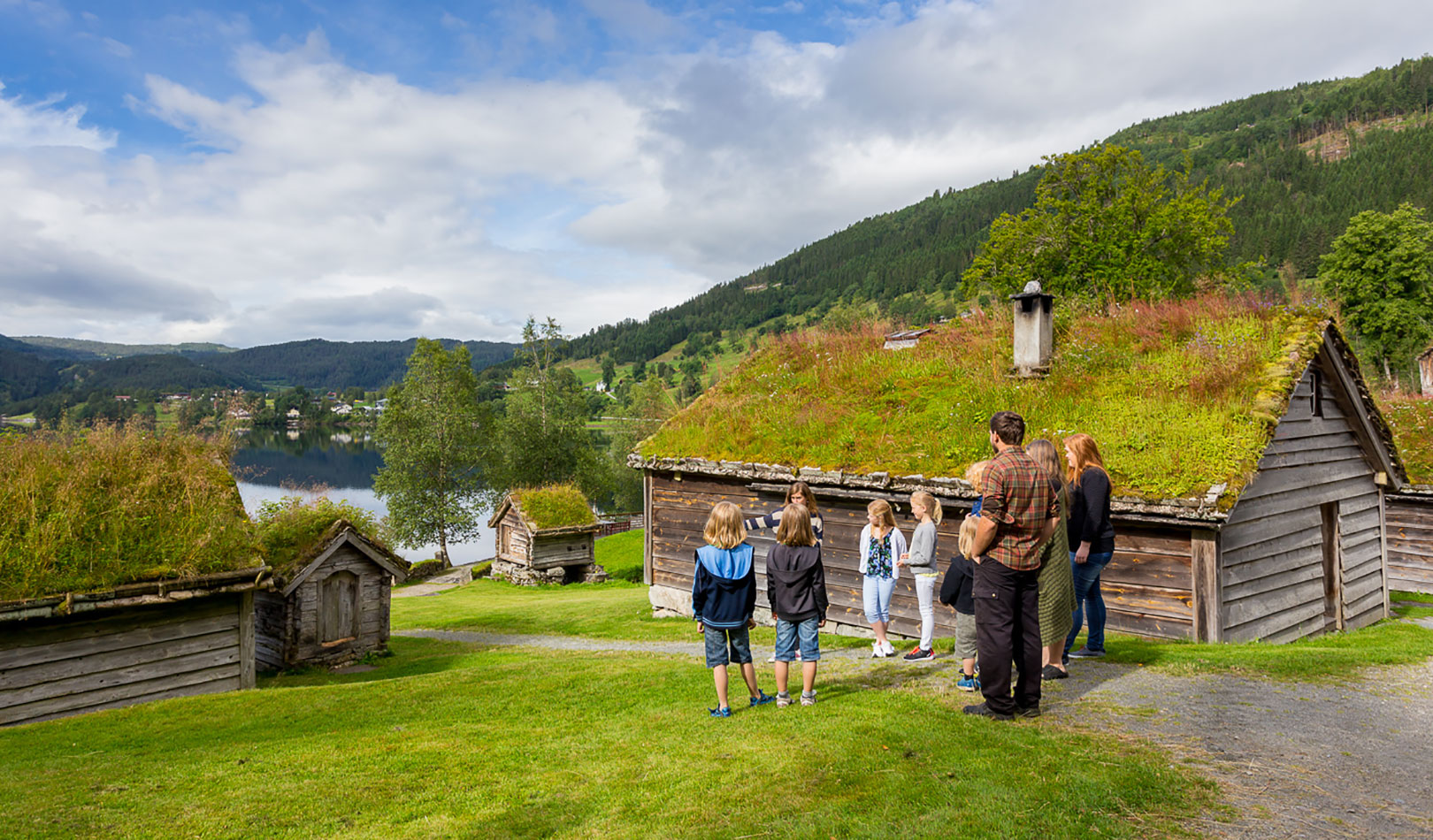 Families with children on a guided tour amongst the builded heritage at Sunnfjord Museum.