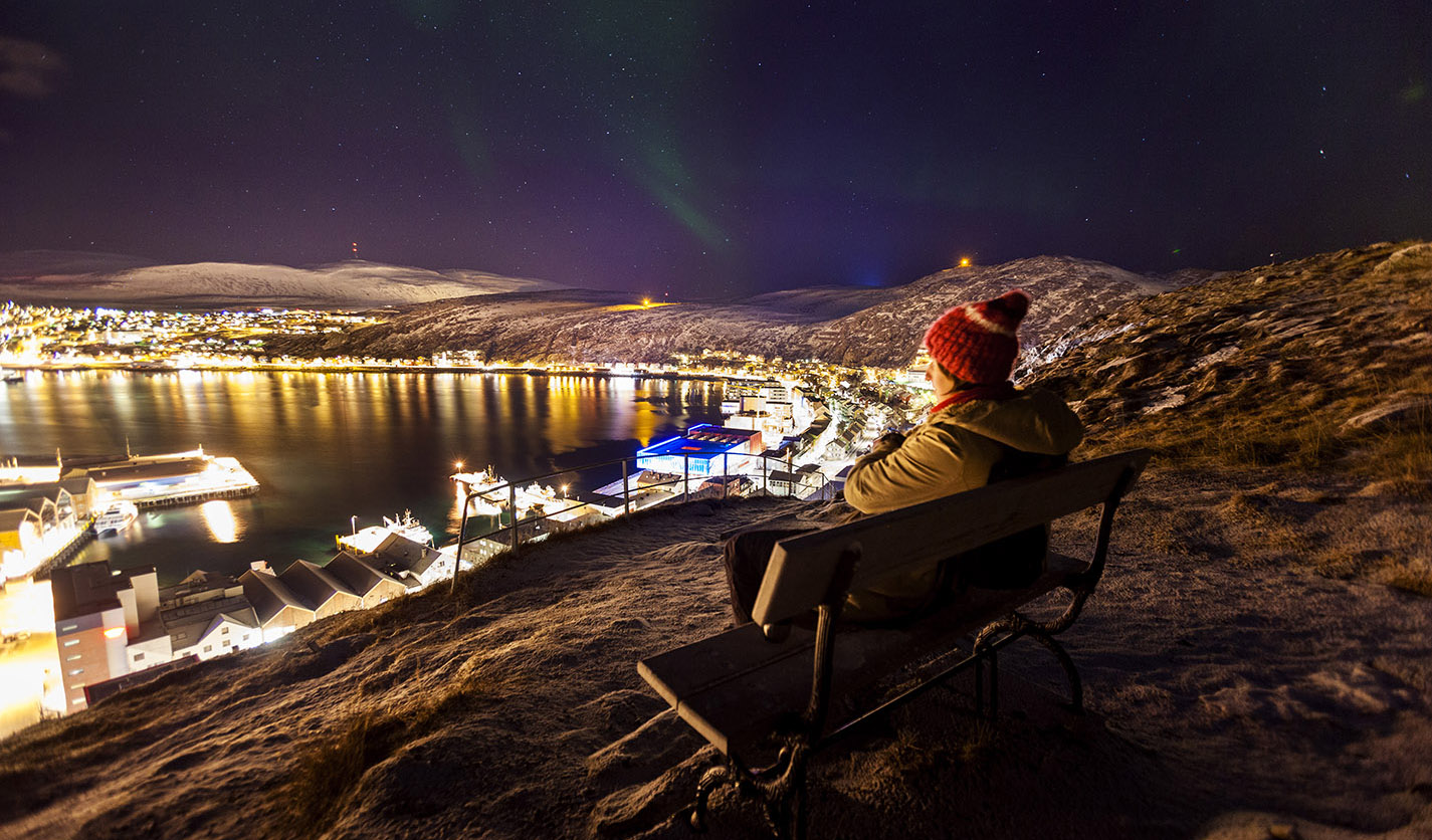 Hammerfest from the rock Mt. Salen with dancing northern lights above.