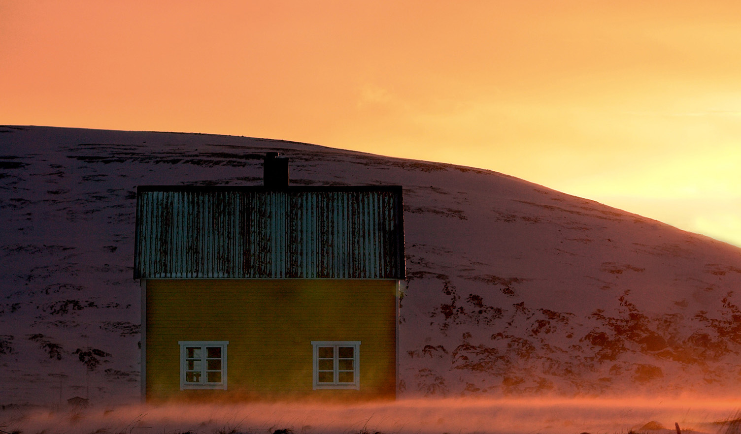 Old house in the windy winter lanscape, Hasvik, Finnmark.