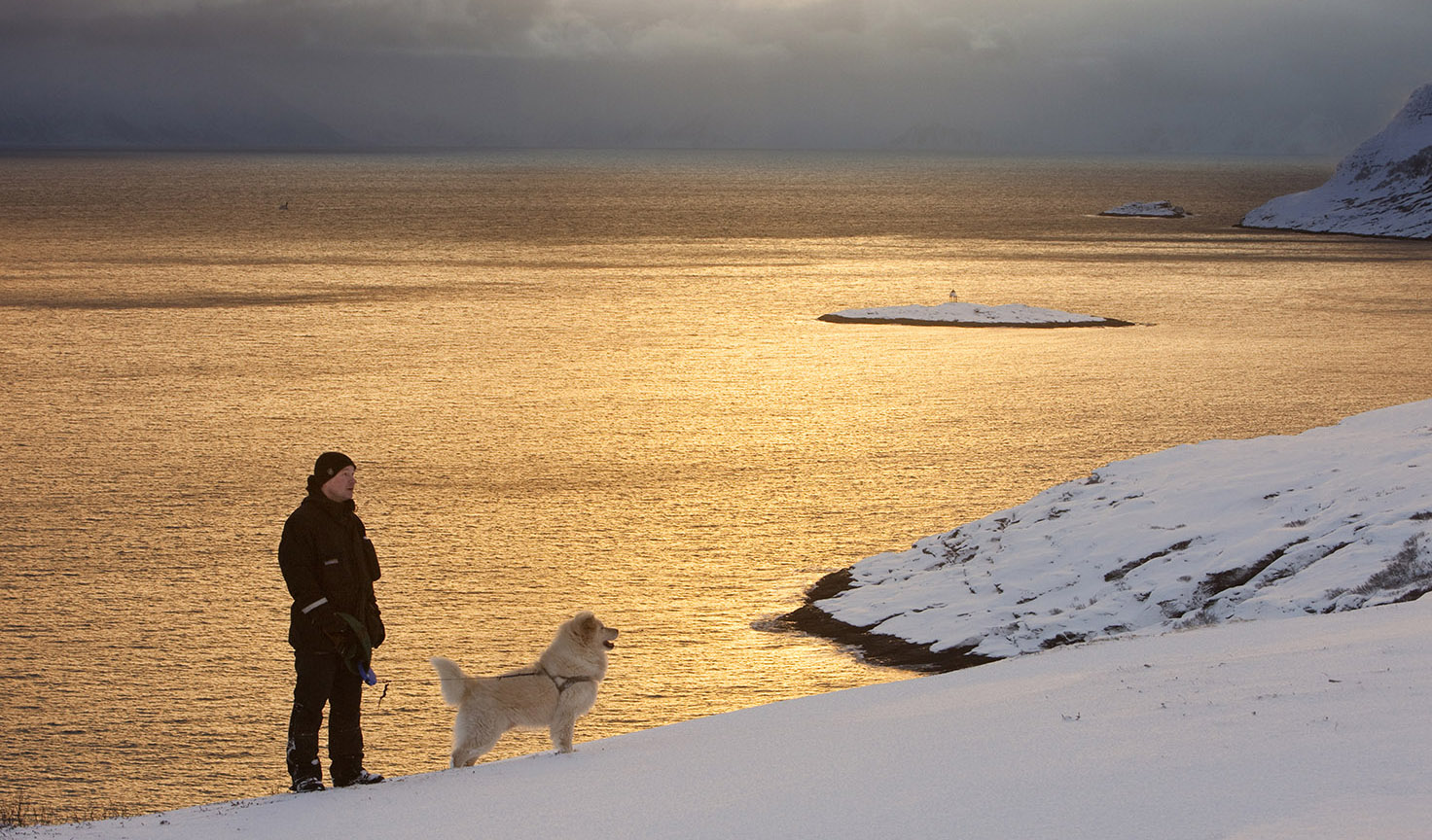 Man with dog in Sørøya, Hasvik, Finnmark.