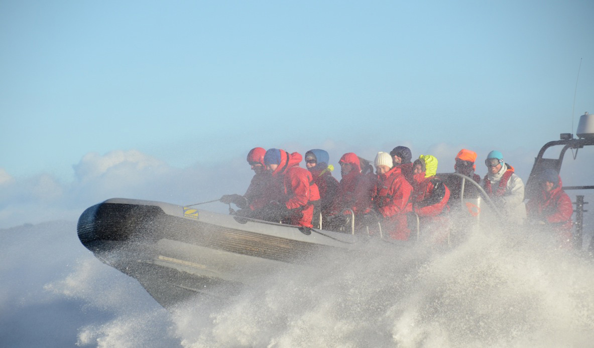 A group of people on a RIB boat outside Haugesund.