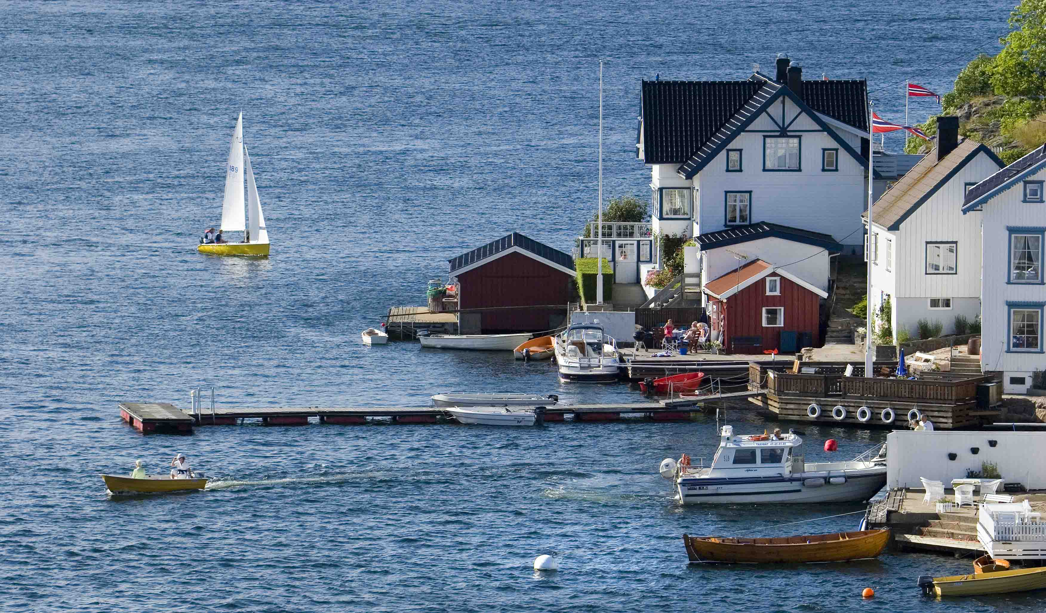 Sail boat, docks and houses on Lyngør, Kristiansand.
