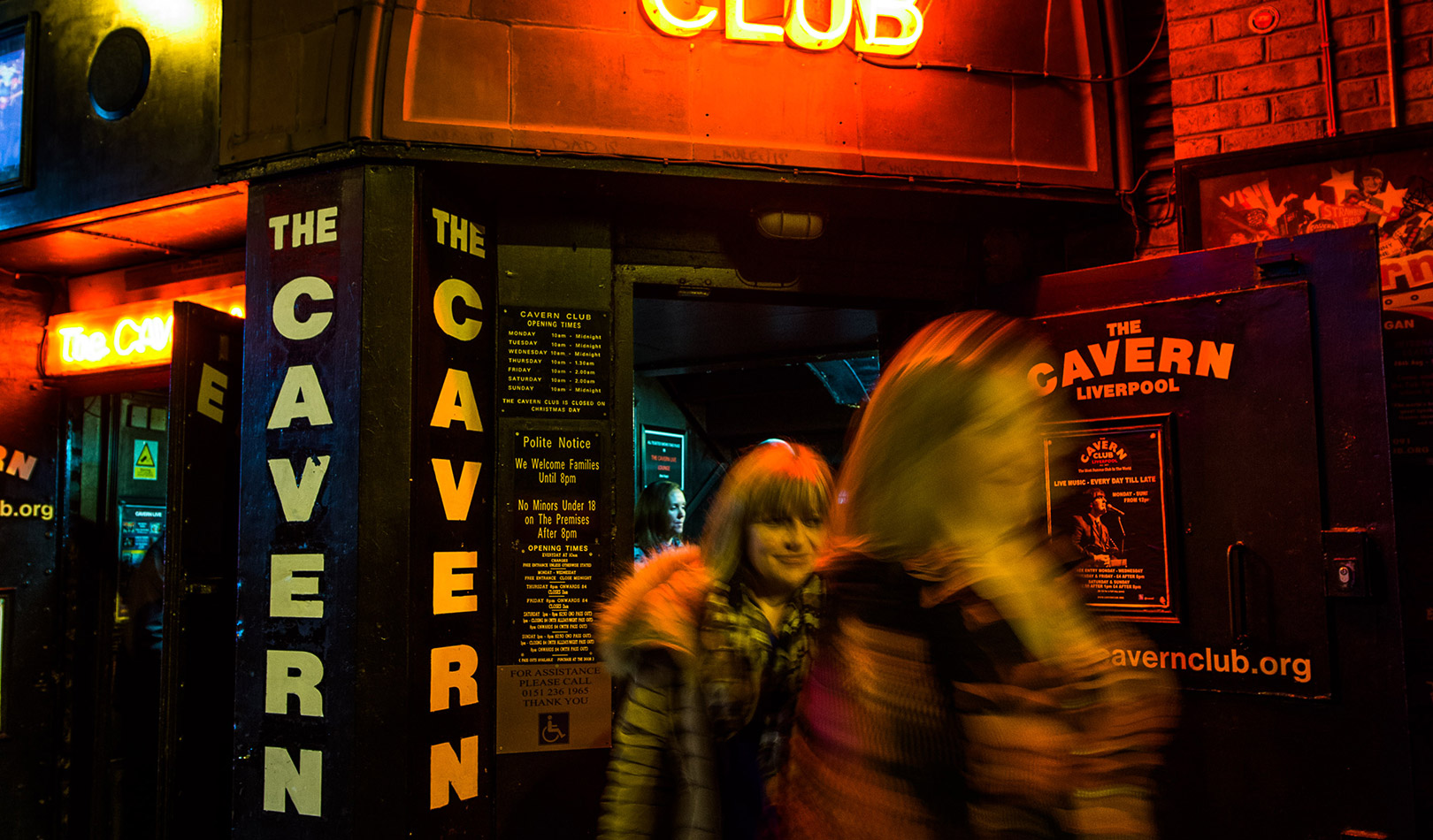 Neo sign and people exiting the Cavern Club in Liverpool.