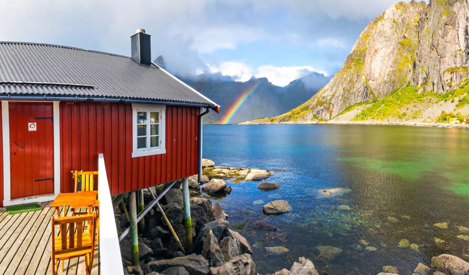 Red sea cabin with ocean, mountains and rainbow.