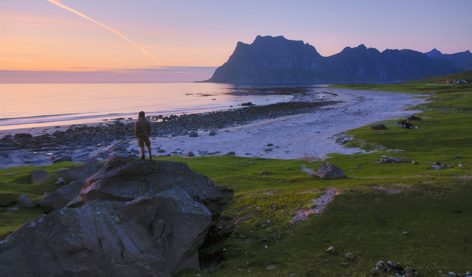 Beach, mountain and ocean at sunset in Lofoten.