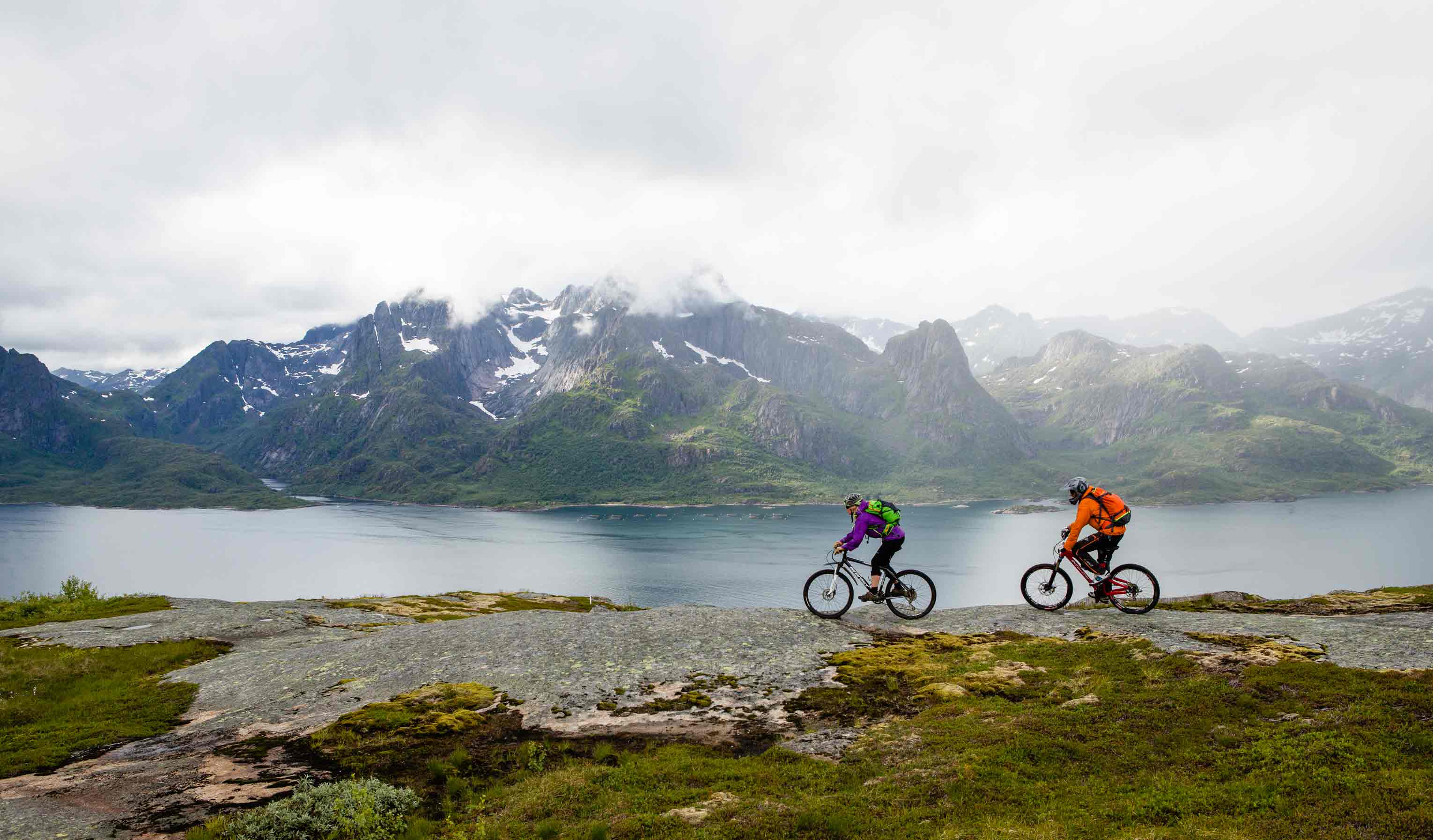 Two bikers on the coast of Vestvågøy, Lofoten.