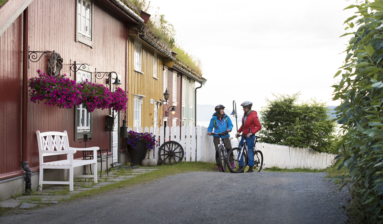 Two cyclists and pittoresque houses in Mo i Rana.