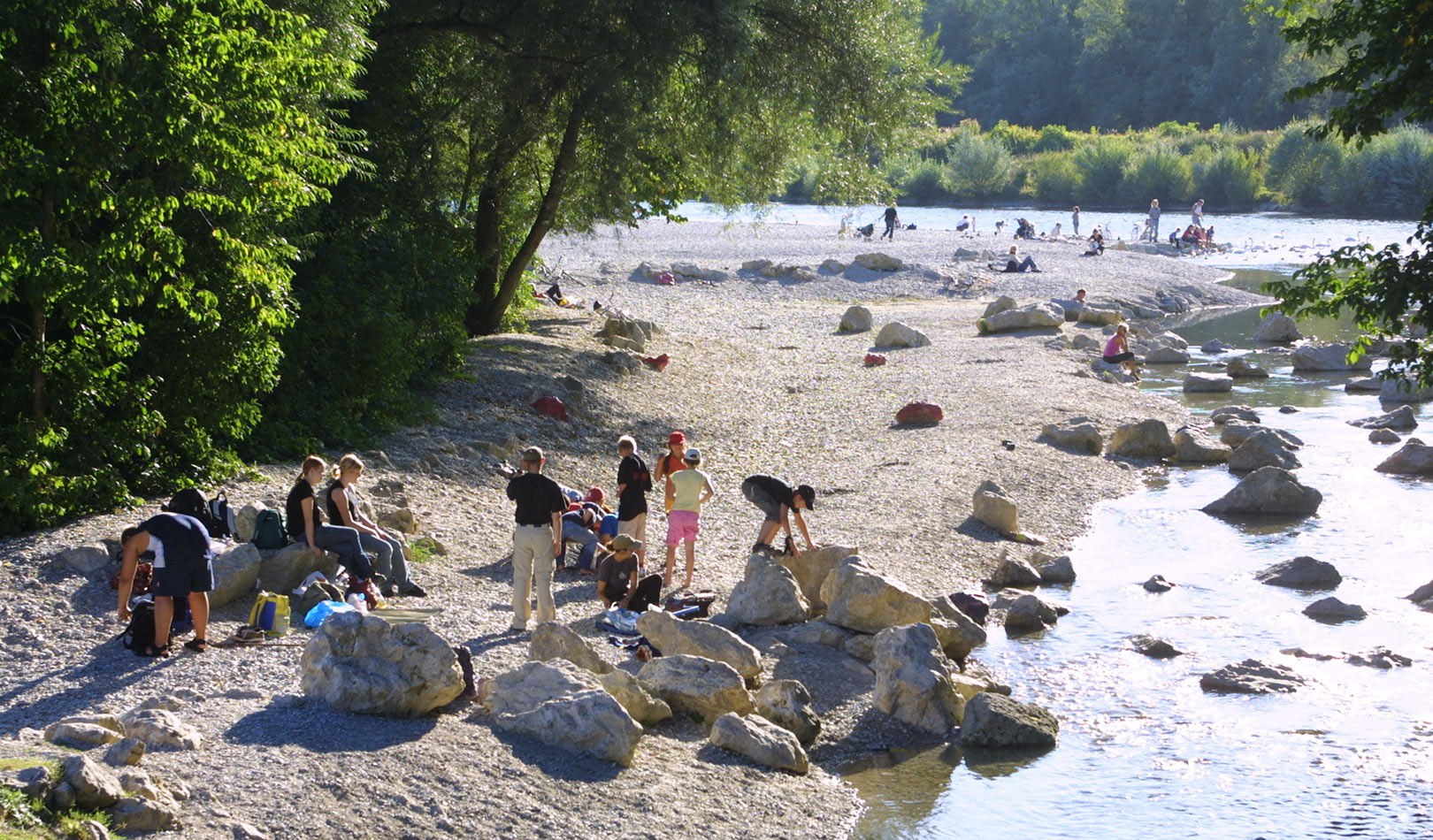 People by the Isar River Munich.