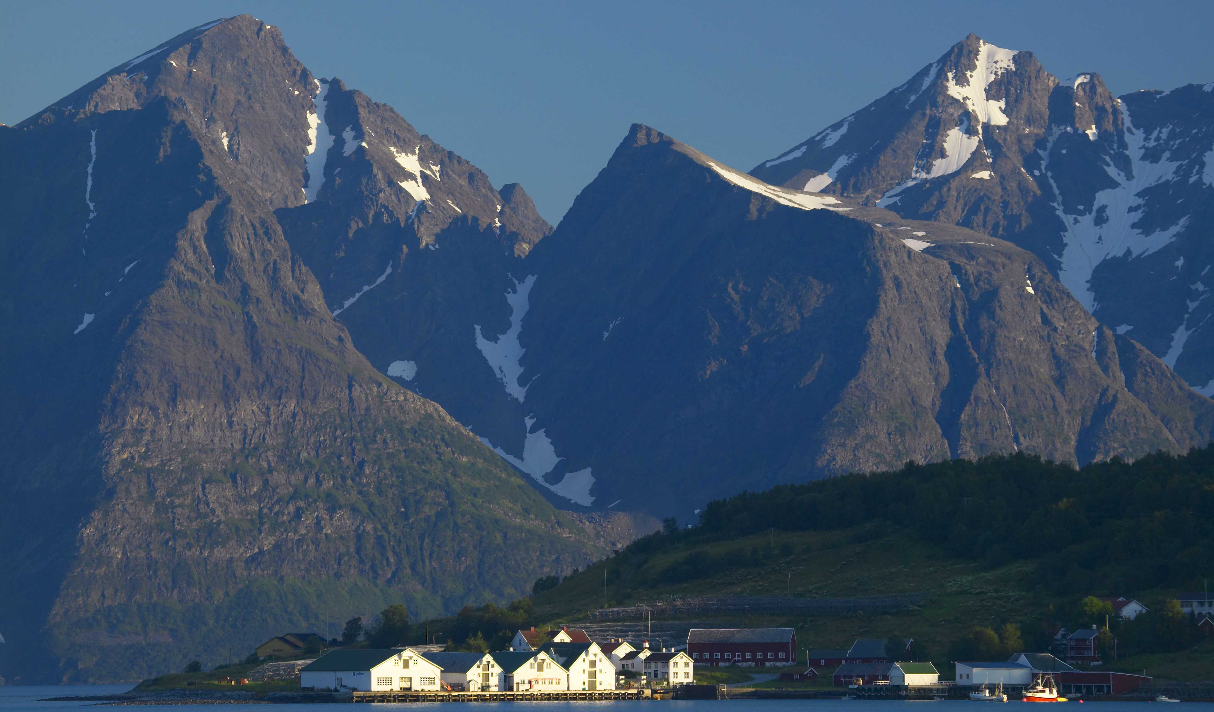 Hamnnes trading place with mountains in the background, Nordreisa, Troms.
