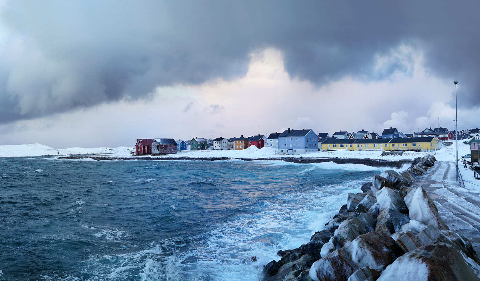 Heavy clouds, roaring waves in Vardø